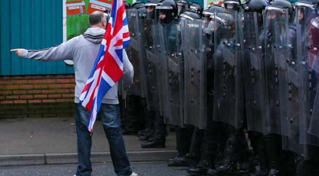 PSNI officers on the Lower Newtownards road, Belfast January 5 2013