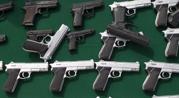 Toy handguns are displayed at a government ceremony in Mexico City (AP/Alexandre Meneghini)