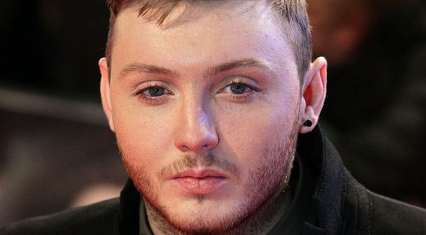 James Arthur's Impossible has remained at number one in the UK singles chart despite stiff competition