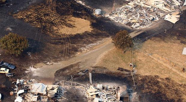 Homes destroyed by a wildfire between Dunalley and Boomer Bay, east of the Tasmanian capital of Hobart, Australia (AP/Chris Kidd, Pool)