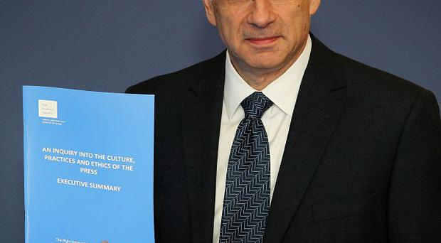 Lord Justice Leveson with the report into media ethics