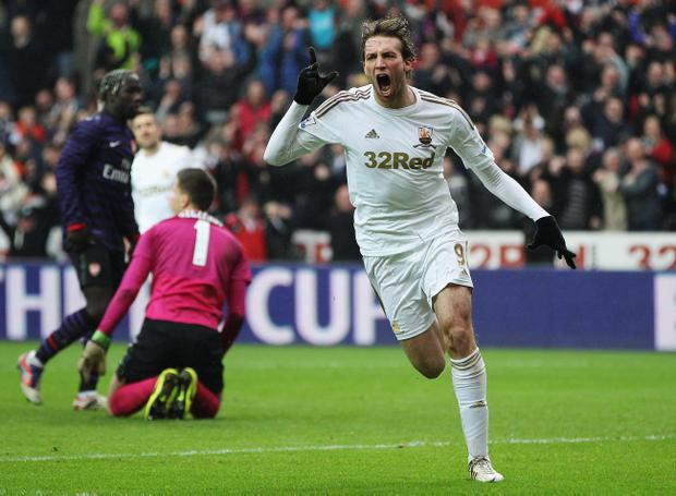 SWANSEA, WALES - JANUARY 06: Miguel Michu of Swansea City celebrates as he scores their first goal during the FA Cup with Budweiser Third Round match between Swansea City and Arsenal at Liberty Stadium on January 6, 2013 in Swansea, Wales. (Photo by Ben Hoskins/Getty Images)