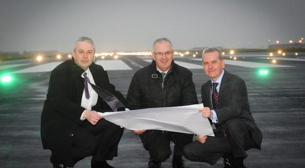 Ready to take flight: Regional Development Minister Danny Kennedy (centre) with Belfast International Airport managing director John Doran (right) and Whitemountain managing director Mark Kelly