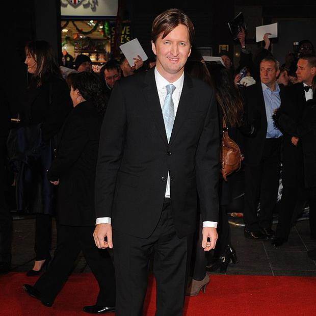 Tom Hooper fell in love with acting after he was cast in a school musical