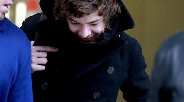 One Direction's Harry Styles has swapped a British winter for a sunshine break with Taylor Swift