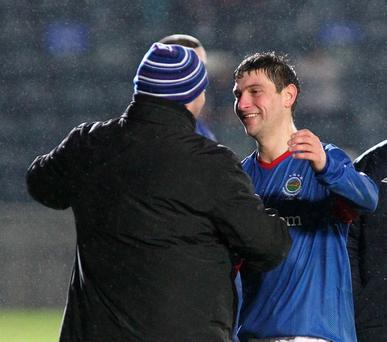 Matthew Tipton is congratulated by Linfield manager David Jeffrey after scoring a hat-trick against Coleraine
