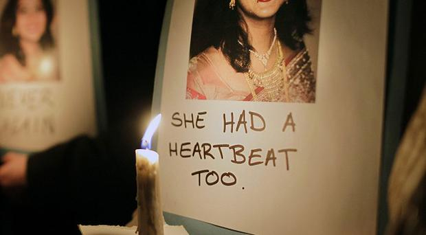 Protesters gather outside Dublin's Leinster House in memory of Savita Halappanavar