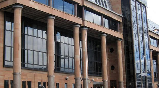 Cell conditions were poor at Newcastle Crown Court, a report found