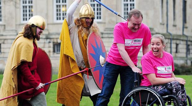 Mike Tomlinson and Hannah Cockcroft are chased by two Roman soldiers during the launch of the first ever Yorkshire Marathon in York