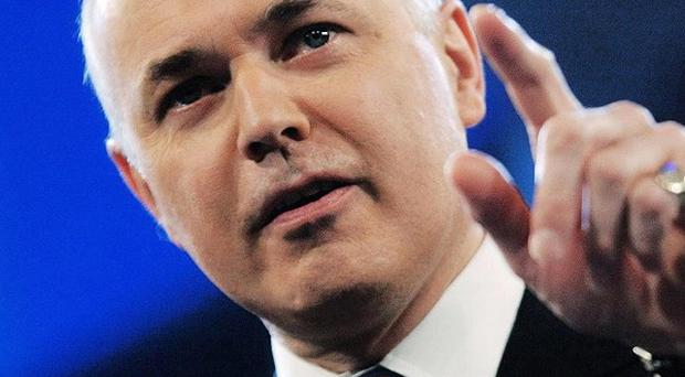 Iain Duncan Smith accused Labour of tying working families into the benefits system and 'buying votes' by increasing handouts