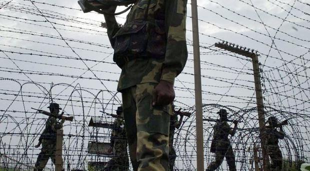Soldiers patrol the India-Pakistan border (AP)