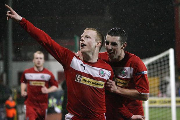 Cliftonville's George McMullan celebrates his double scored in front of a live TV audience