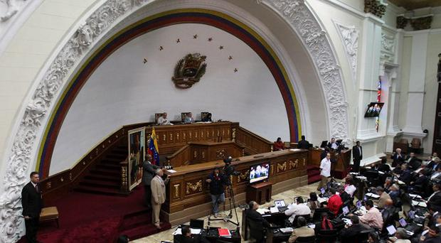 Members of Venezuela's National Assembly attend a session in Caracas (AP)