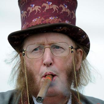 TV racing pundit John McCririck is suing Channel 4