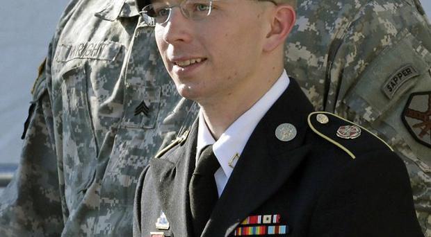 Bradley Manning is escorted out of a courthouse in Fort Meade after a pre-trial hearing (AP)
