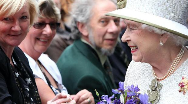 The British Queen, pictured meeting well-wishers in Dublin, was the most high-profile visitor to Ireland last year