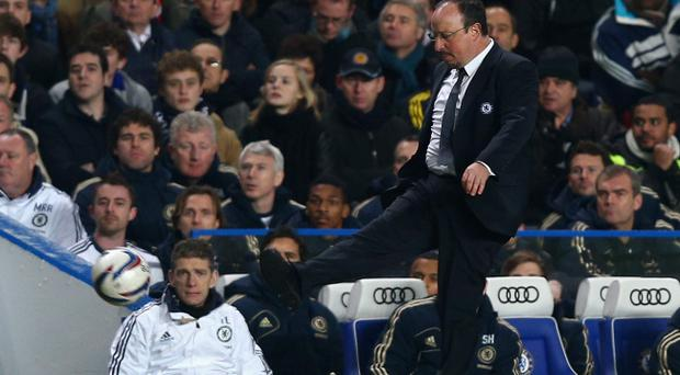LONDON, ENGLAND - JANUARY 09: Rafael Benitez, manager of Chelsea kicks the ball during the Capital One Cup Semi-Final first leg match between Chelsea and Swansea City at Stamford Bridge on January 9, 2013 in London, England. (Photo by Clive Rose/Getty Images)