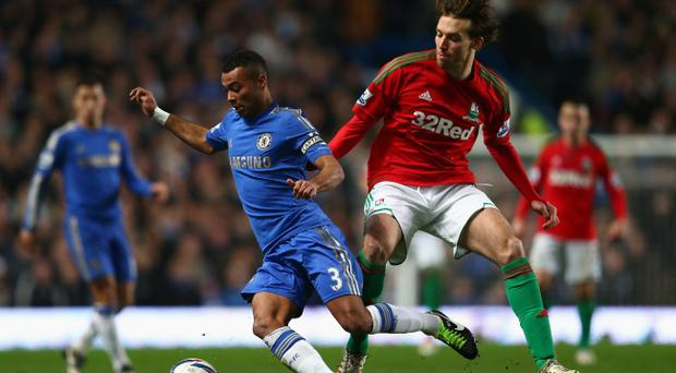 LONDON, ENGLAND - JANUARY 09: Ashley Cole of Chelsea is closed down by Michu of Swansea City during the Capital One Cup Semi-Final first leg match between Chelsea and Swansea City at Stamford Bridge on January 9, 2013 in London, England. (Photo by Clive Mason/Getty Images)