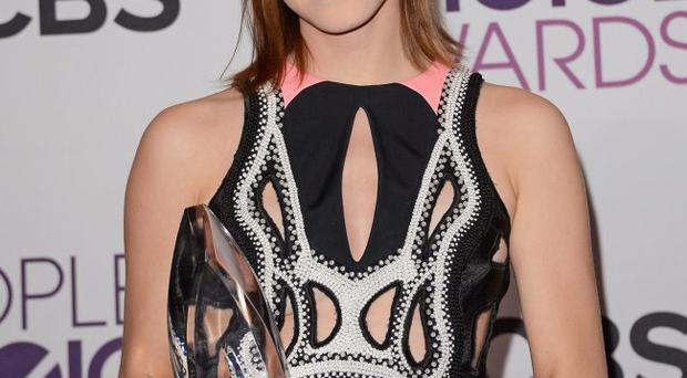 Actress Emma Watson poses with Favorite Drama Movie award for