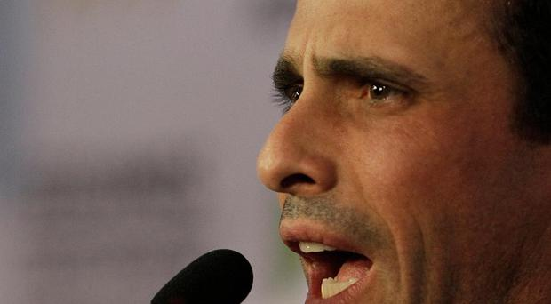 Opposition leader Henrique Capriles condemned the Supreme Court's endorsement of delaying the inauguration (AP)