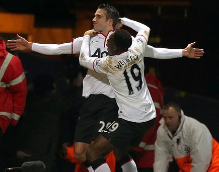 Robin van Persie celebrates his equaliser against West Ham which earned a replay