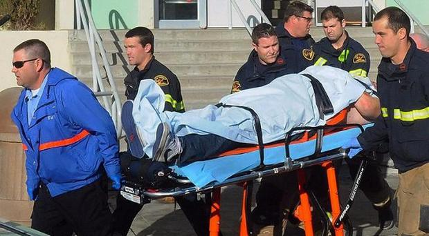 Paramedics transport a student wounded during a shooting at a high school in California (AP/Taft Midway Driller, Doug Keeler)