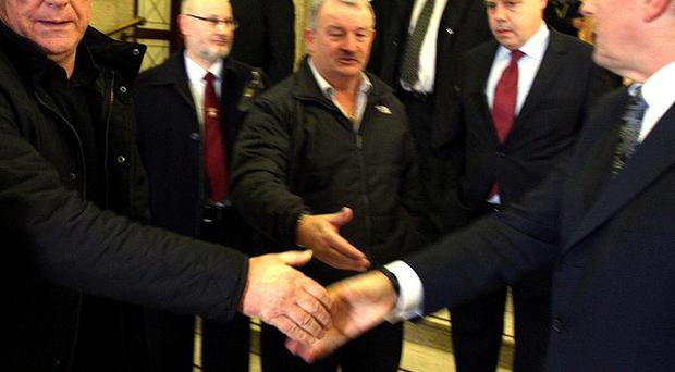UDA Leader Jackie McDonald shakes hands with First Minister Peter Robinson at Stormont after the first meeting of the Ulster Unionist Forum in January