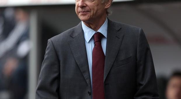 Arsene Wenger insists new players will have to come in before any more leave the Emirates