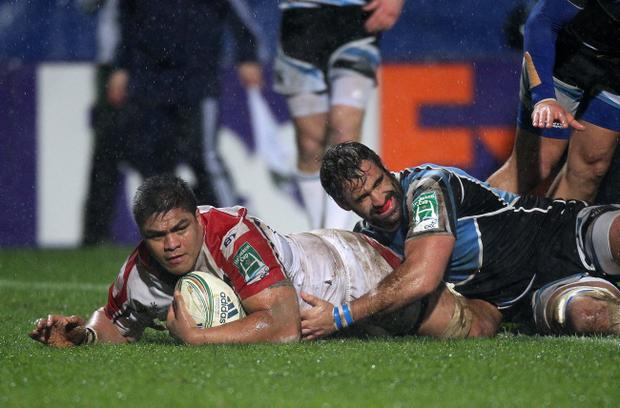 Nick Williams goes over to score for Ulster, tackled by Glasgow's Josh Strauss