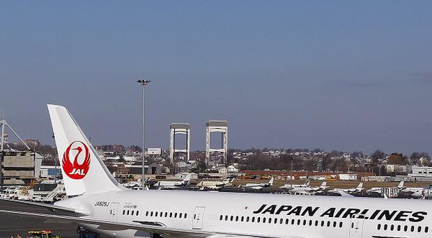 A Japan Airlines Boeing 787 Dreamliner surrounded by emergency vehicles at Boston's Logan International Airport (AP)