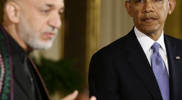 President Barack Obama listens as Afghan President Hamid Karzai speaks during their joint news conference at the White House (AP)