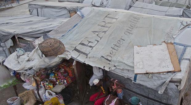 Residents of a camp for people displaced by the 2010 earthquake in Haiti (AP)