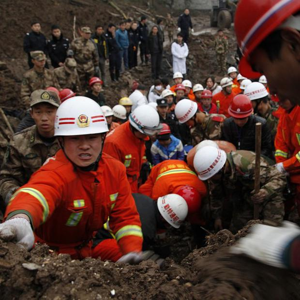 Rescuers work at the site of a landslide in China (AP/Xinhua Zhang Guangyu)