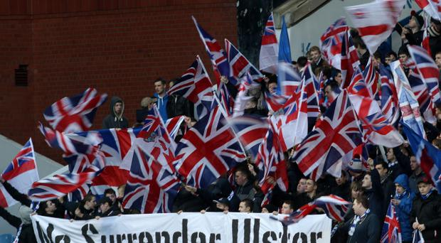 Rangers fans show their support to the Union flag protesters in Belfast during the Irn Bru Scottish Third Division match at Ibrox, Glasgow.