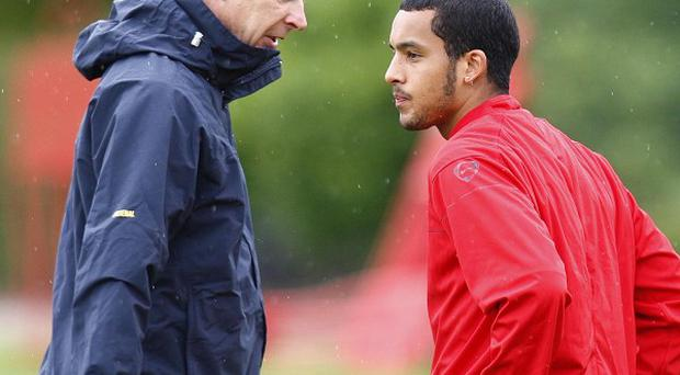 Manager Arsene Wenger, left, is confident Theo Walcott, right, will sign a new contract