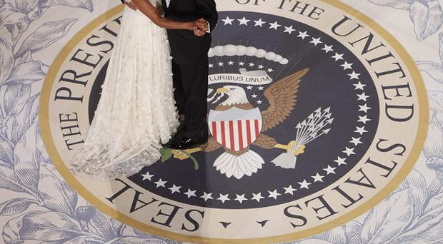 President Barack Obama and First Lady Michelle Obama dance at the Commander in Chief Inaugural Ball in Washington in 2009 (AP)