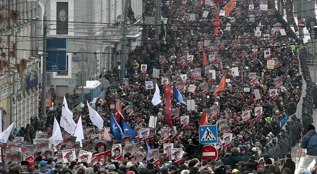 People march during a protest rally in Moscow, Russia (AP)