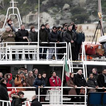 Relatives of the 32 victims of the Costa Concordia shipwreck, aboard a ferry approach the ship off the Tuscan Island Isola del Giglio (AP)