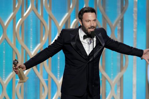 Actor Ben Affleck accepts the Best Director award for Motion Picture,