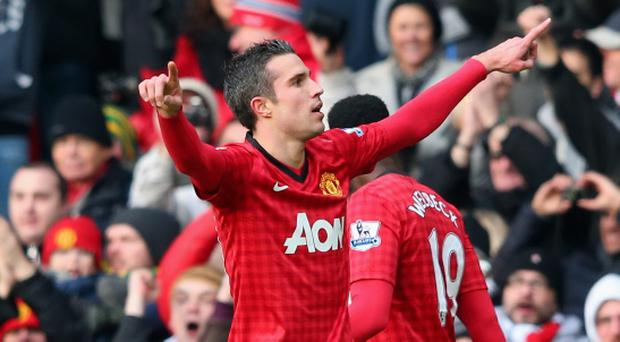 MANCHESTER, ENGLAND - JANUARY 13: Robin van Persie of Manchester United celebrates scoring the opening goal during the Barclays Premier League match between Manchester United and Liverpool at Old Trafford on January 13, 2013 in Manchester, England. (Photo by Alex Livesey/Getty Images)