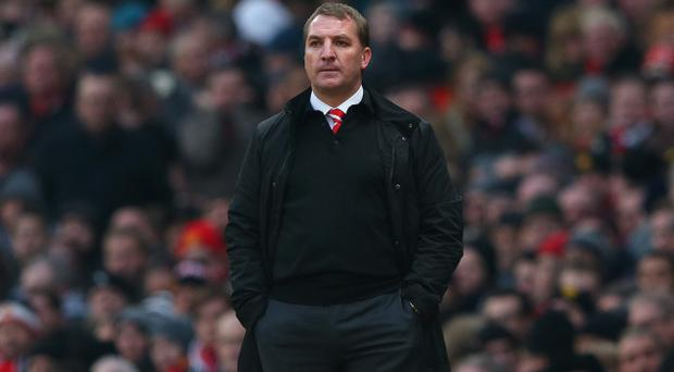 MANCHESTER, ENGLAND - JANUARY 13: Liverpool Manager Brendan Rodgers looks on during the Barclays Premier League match between Manchester United and Liverpool at Old Trafford on January 13, 2013 in Manchester, England. (Photo by Alex Livesey/Getty Images)
