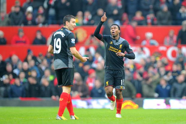 Liverpool's Daniel Sturridge (right) celebrates scoring his team's first goal of the game with teammate Stewart Downing (left) during the Barclays Premier League match at Old Trafford, Manchester