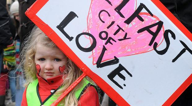Holly Reynolds, aged four, joins peace protesters at Belfast City Hall