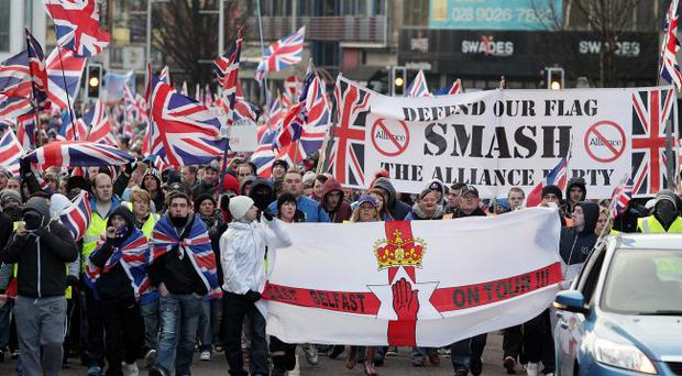 Enough is enough: Angry loyalist protesters take to the streets and many are not happy with First Minister Peter Robinson