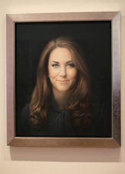 A newly-commissioned portrait of Kate, Duchess of Cambridge, by artist Paul Emsley hangs at the National Portrait Gallery in London