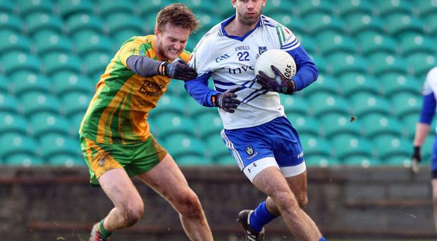 Neil McAdam of Monaghan is challenged by Ross Wherity of Donegal