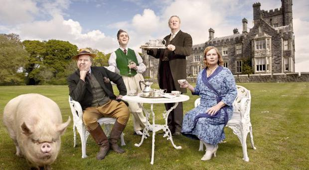 The cast of Blandings and, in the background, Crom Castle