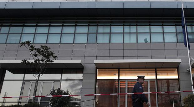 An attacker fired an automatic rifle at the New Democracy party headquarters in Athens (AP)