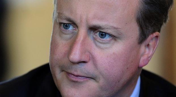 UK Prime Minister David Cameron, pictured, and French president Francois Hollande said the situation in Mali poses a threat to international security
