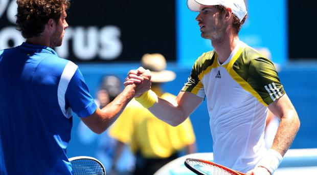 MELBOURNE, AUSTRALIA - JANUARY 15: Andy Murray of Great Britain shakes hands at the net with Robin Haase of the Netherlands after winning his first round match against during day two of the 2013 Australian Open at Melbourne Park on January 15, 2013 in Melbourne, Australia. (Photo by Cameron Spencer/Getty Images)